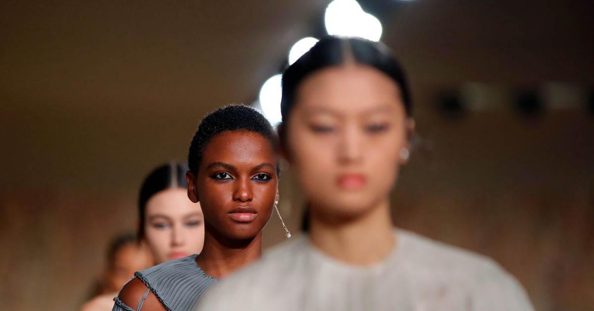Dior show celebrates fashion up close and personal after pandemic - Reuters