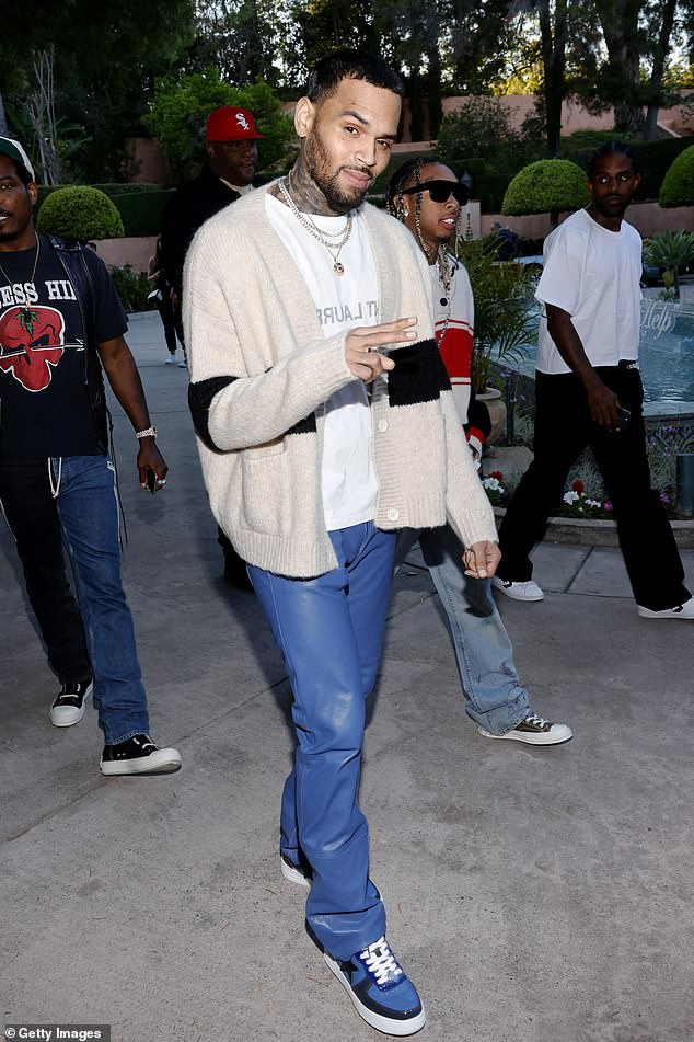 Chris Brown flashes peace sign with Tyga at RHUDE fashion show... amid investigation for battery - Daily Mail